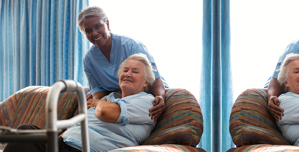 caregiver and patient lying in a sofa